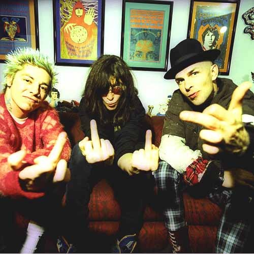NEW YORK - APRIL 1997: (EDITORS NOTE: THIS IMAGE WAS CREATED USING CROSS-PROCESSED FILM) (L-R) Rancid bandmate Lars Fredericksen, The Ramones Joey Ramone and Rancid leader Tim Armstrong pose together for an April 1997 portrait at Joey Ramone's apartment in New York City, New York.  Rancid's Tim Armstrong and Lars Fredericksen met Joey for the first time, to discuss their planned tour, where the Ramones come out of retirement for a final performance at Lollapalooza. (Photo by Bob Berg/Getty Images)